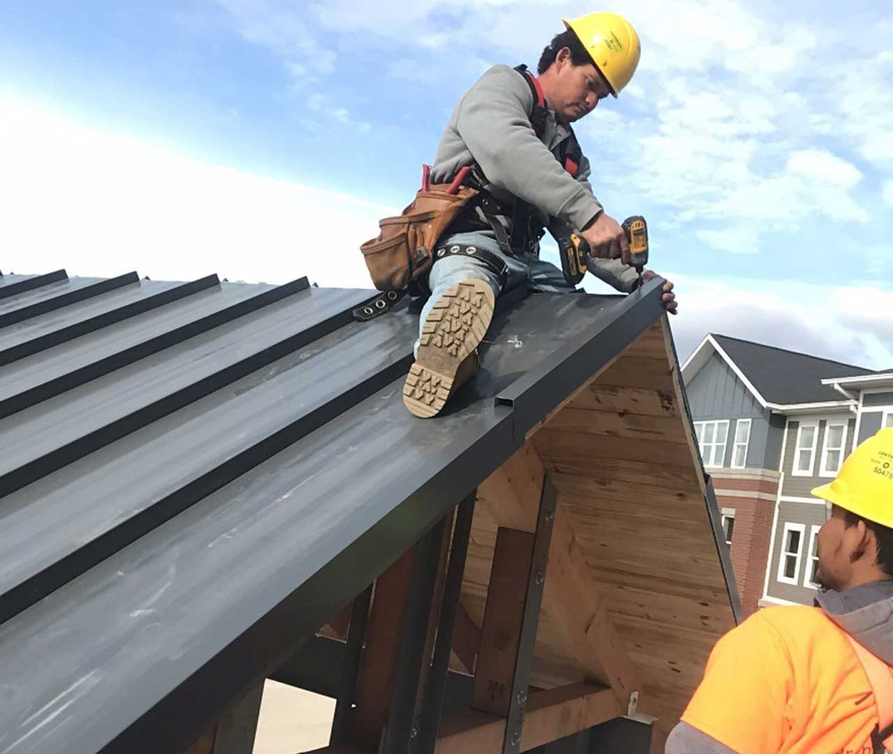 roofer installing a roof on a home