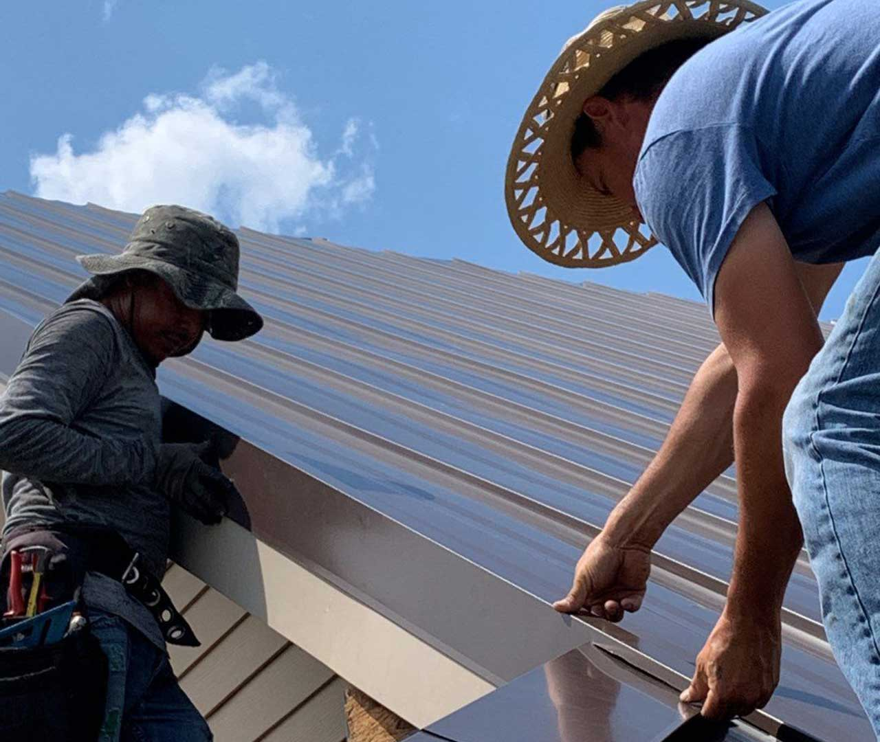 roofers installing metal roof