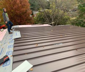 roofer showing off his newly done roof